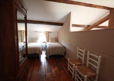 Slaapkamer op de vide van gîte Petit Paradis